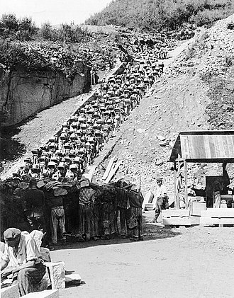 "Extermination through labour - The Todesstiege (""Stairs of Death"") at the Mauthausen concentration camp quarry in Upper Austria. Inmates were forced to carry heavy rocks up the stairs. In their severely weakened state, few prisoners could cope with this back-breaking labour for long."