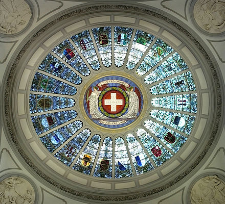 The 22 cantonal coats of arms (all but Jura, with the half-cantons represented jointly) in stained glass set in the dome of the Federal Palace of Switzerland (c. 1900) Bundeshauskuppel Standesscheiben.jpg