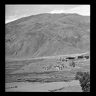 Songtsen Gampo - King Songtsen Gampo burial mound surrounded by cultivated fields, Chyongye Valley, Tibet 1949
