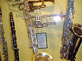 C.G. Conn Alto Saxophone (1923) and other wind instruments, Museum of Making Music.jpg