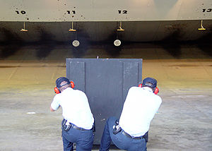 Coast Guard Investigative Service - CGIS agents conducting firearms training