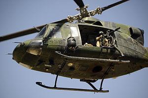 "Bell CH-146 Griffon - CH-146 Griffon in Afghanistan armed with a Dillon Aero M134D ""Minigun"""