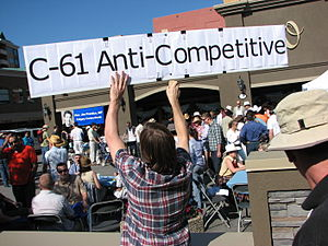 An Act to amend the Copyright Act (39th Canadian Parliament, 2nd Session) - An opponent of the proposed Bill C-61 holds up a protest sign at a public breakfast event held during the Calgary Stampede by Canadian Industry Minister Jim Prentice.
