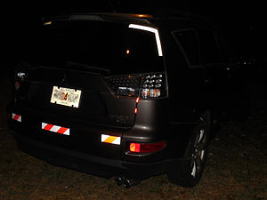 Retroreflective sheeting - Car with reflective stickers. Flash photo.