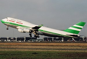 Cathay Pacific - A Cathay Pacific Boeing 747-400 in old livery without the Union Flag taking off from Amsterdam Airport Schiphol in 1996. This was prior to the 1997 handover.