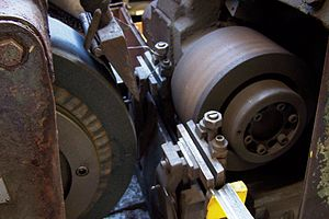 Centerless grinding - A close-up of the grinding wheel and back-up wheel