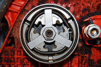 Centrifugal clutch - A chainsaw's clutch. The chain wraps around a sprocket behind the clutch that turns with the outer drum.