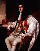 Painting of seated male figure, with long black hair wearing a white cape and breeches.