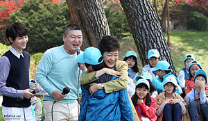 Koreans - Children's Day in Cheong Wa Dae. South Korean President Park Geun-hye (center) hugs a boy at a meeting with children invited to Cheong Wa Dae to mark Children's Day on May 5