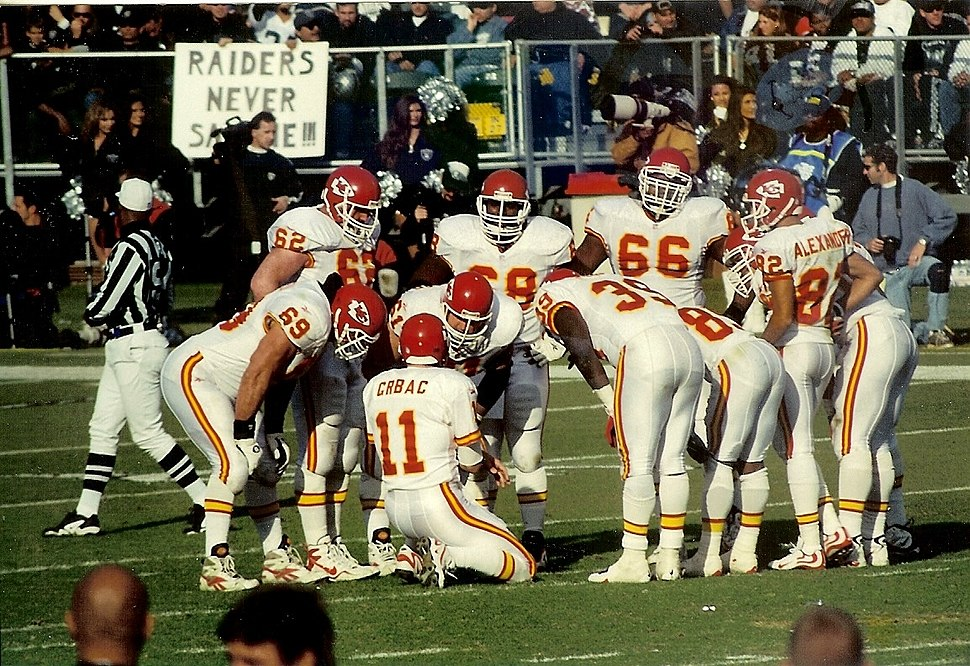 Chiefs players in huddle