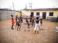 Children play and rejoice during the first rainfall of the year in Mararaba, Nassarawa state, Nigeria.jpg