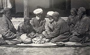Khitan (circumcision) - Circumcision being performed in central Asia (probably Turkestan), c. 1865–1872.  Restored albumen print.