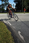 Competitors swim, bike, run to finish line 140816-M-BN069-022.jpg