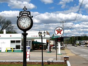 Cowan, Tennessee - Street clock and Texaco station along US 41A in Cowan