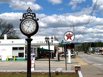 Cowan, Tennessee - Street clock and Texaco station along US 41A in Cowan