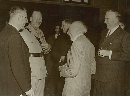 Four Prime Ministers in 1945: Labor Prime Minister John Curtin (left) shares a joke with the Governor General Prince Henry (in uniform) with former Country Party Prime Minister Arthur Fadden, Nationalist Prime Minister Billy Hughes and UAP Prime Minister Robert Menzies. Curtin GGPrinceHenry Fadden Hughes Menzies.jpg