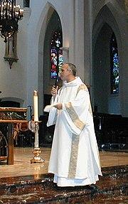 Roman Catholic deacon wearing a dalmatic