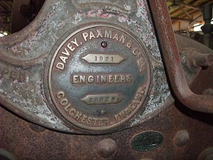 Paxman (engines) - Detail view of same portable engine, showing Paxman builder's plate (dated 1921) on the regulator handle support above the firebox.