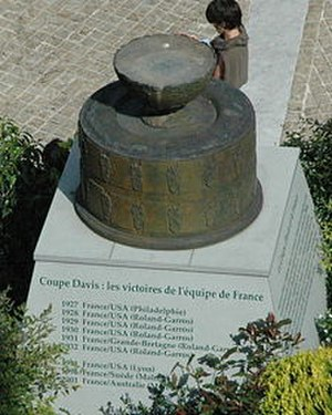 Stade Roland Garros - Monument in Place des Mousquetaires to France's string of Davis Cup victories (1927–1933).  Roland Garros was constructed to provide a venue for France's first successful Cup defense in 1928.