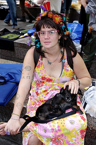 Flower child - A protester dressed as a flower child at the Occupy Wall Street event, September 24, 2011