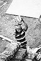 Day labour carring bricks in head.jpg