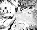 Debris swept into parking area at dormitory by flood. Water and mud entered basement. ; ZION Museum and Archives Image ZION 8587 (db72cc290d2642dda08a9aaeb61bf7a0).jpg