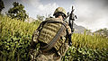 Defense.gov News Photo 110912-F-RN211-161 - U.S. Army Spc. Jake Amato an MK48 machine gunner assigned to Laghman Provincial Reconstruction Team patrols through a field looking for triggermen.jpg