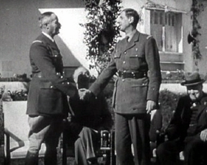 Casablanca Conference - Leaders of the Free French forces: General Henri Giraud (L) and General Charles de Gaulle (R) at the Casablanca Conference. In the background are Roosevelt and Churchill