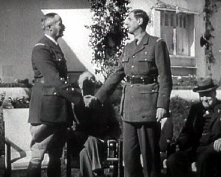Henri Giraud and de Gaulle during the Casablanca Conference in January 1943. Churchill and Roosevelt are in the background. Degaulle-freefrench.png