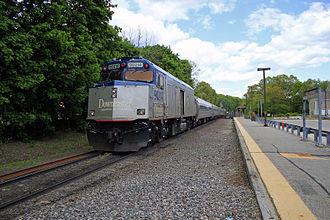 Downeaster (train) - A Downeaster train passing the Ballardvale MBTA Commuter Rail station