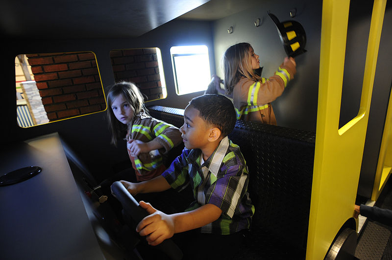 File:Driving the fire truck at Glazer Children's Museum.JPG