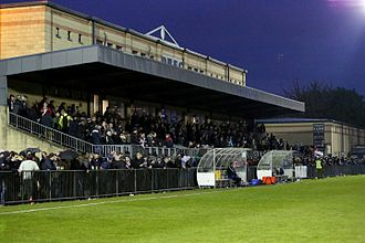 Dulwich Hamlet F.C. - Champion Hill main stand, and dugouts in April 2017.