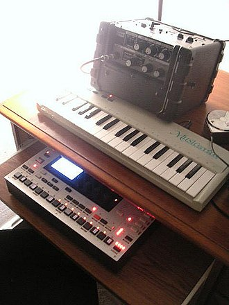 Keyboard amplifier - A tiny BOSS micro-cube keyboard amp being used with a MIDI keyboard.