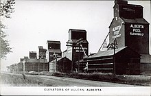 View of the row of grain elevators in Vulcan, Alberta. After 1920.