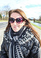 Female with sunglasses en coat Holland.jpg