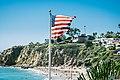Flag over a beach (Unsplash).jpg
