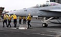 Flickr - Official U.S. Navy Imagery - Sailors position a jet on the flight deck..jpg