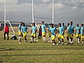 Footballers from P.E. Stars Football Club in South Africa warm up under a brewing storm.jpg