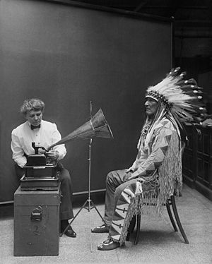 Music industry - Frances Densmore recording Blackfoot chief Mountain Chief on a cylinder phonograph in 1916.