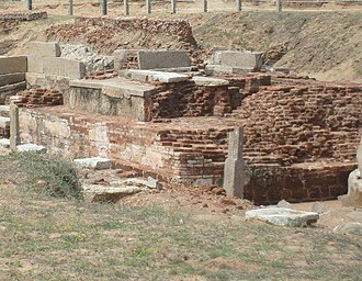 Murugan Temple, Saluvankuppam - The Garbhagriha or sanctum sanctorum of the Murugan Temple, Saluvankuppam. While the thin, tabular bricks at the top were laid by the Pallavas, the larger bricks underneath date from the Sangam period