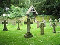Geometrically precise crosses behind St Nicholas, Chawton - geograph.org.uk - 936508.jpg