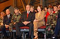 George W. Bush and Laura Bush sit together on the stage before a full house in Hangar 3 at Elmendorf Air Force Base, Alaska.jpg