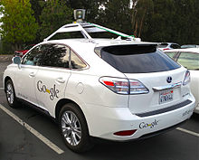Lexus RX 450h with attachment on top and Google logo on the side