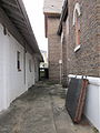 Grace ME Church Iberville NOLA lake side alley.JPG
