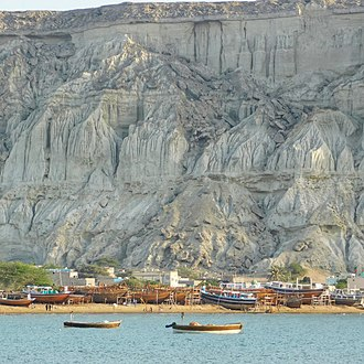 Gwadar - Fishing boats in Gwadar East Bay with the Koh-e-Mehdi Hills in the background