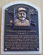A metal plaque with Stengel's face and achievements