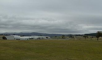 Headquarters Joint Operations Command (Australia) - L-R: Gymnasium, Mess, 100m gate entrance, main building, car park, 100m fence. To the right is part of the Kowen forest in the Australian Capital Territory