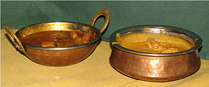 Karahi - A small decorative copper-plated karahi (left) and handi (right) used to serve Indian food.
