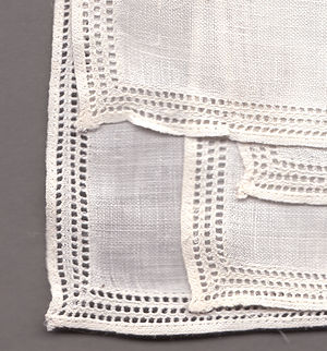 Drawn thread work - Linen handkerchief decorated with three rows of hemstitching.
