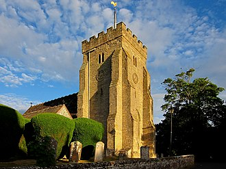St Peter's Church, Henfield - The church tower and some of the churchyard's 104 clipped yews